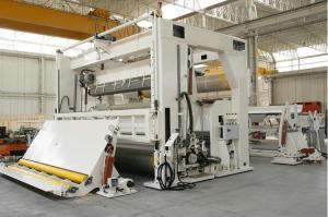 High speed rewinding machine with lower draft paper